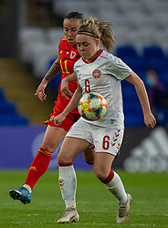 CARDIFF, WALES - Tuesday, April 13, 2021: Denmark's Nanna Christiansen (R) and Wales' Natasha Harding during a Women's International Friendly match between Wales and Denmark at the Cardiff City Stadium. (Pic by David Rawcliffe/Propaganda)