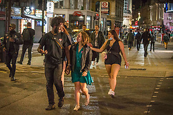 ©️ Licensed to London News Pictures. 11/09/2020. London, UK. Revellers make the most of the weekend in Soho, central London. Before social gatherings of more than six people will be illegal in England from Monday with some exemptions - amid a steep rise in coronavirus cases. Photo credit: Marcin Nowak/LNP