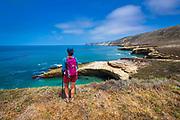 Hiker at Lobo Canyon Beach, Santa Rosa Island, Channel Islands National Park, California USA
