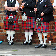 The World Pipe band Championships at Glasgow Green. Young Archie Rodgers (5) holds his ears beside his mum and other members of Penicuik and District Pipe band members as others practice.  Picture Robert Perry The Scotsman  13th August 2011