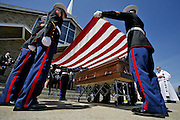 Marines drape the casket with an American flag after exiting the church.  Funeral for Patrick Gallagher a Marine from fairhaven was held at St. Mary's church on Main St. in Fairhaven with the burial being held at the National Cemetary in Bourne.   Local and State officials were present for the somber event.  Marine Lance Cpl. Patrick J. Gallagher 27, of Jacksonville, Fla.; assigned to elements of the 1st Marine Logistics Group, I Marine Expeditionary Force, Camp Pendleton, Calif.; died April 2 when the seven-ton truck he was riding in rolled over in a flash flood near Asad, Iraq. Also killed were: Cpl. Andres Aguilar Jr., Cpl. David A. Bass, Lance Cpl. Felipe D. Sandoval-Flores, Cpl. Brian R. St. Germain and Staff Sgt. Abraham G. Twitchell.