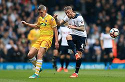 Millwall's Steve Morison (left) and Tottenham Hotspur's Toby Alderweireld (right) battle for the ball