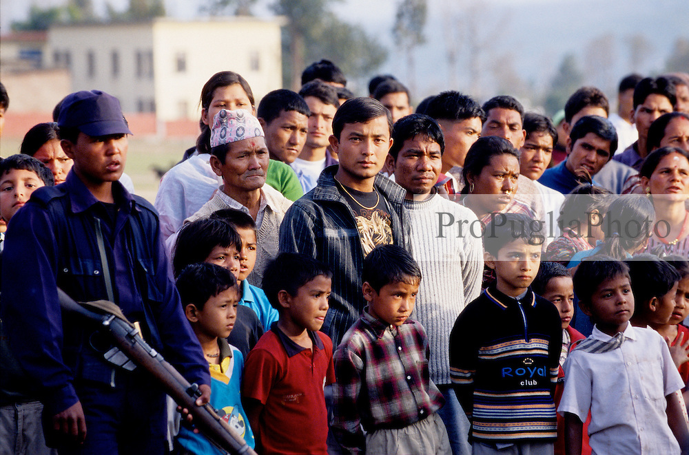 Surkhet, 01 March 2005... The crowd is watching as the Policemen are paying tribute to their colleague killed during an ambush by the Maoists.
