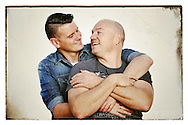 """PERTH, AUSTRALIA - MAY 31:  (L-R) Western Australian couple, Jason Griffiths, age 31 and Mark McCarthy age 43 pose during a portrait session on May 31, 2015 in Fremantle, Australia. Jason a Police Officer and Mark a Publican, have been in a defacto relationship for 10 years, never fight or argue and live in Collie, a South West regional town which can be quite discriminatory, support same-sex marriage. """"All for one...Equality !"""", Mark said. The marriage equality debate in Australia has reignited on the back of Ireland's referendum legalising same-sex marriage last week. Recent polls suggest public support for gay marriage in Australia is at an all-time high of 72%.  (Photo by Paul Kane/Getty Images)"""