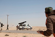Mcc0030300 . Daily Telegraph..Rebel fighters fire katushya rockets towrads Libyan government forces on the frontline near the oil town of Brega..Brega 5 April 2011