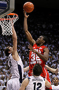 Utah guard Shawn Glover (32) attempts to score as BYU guard Kyle Collinsworth, left, BYU forward Logan Magnusson (12) defend during the second half of an NCAA college basketball game in Provo, Utah, Saturday, Feb. 12, 2011. BYU defeated Utah 72-59.(AP Photo/Colin E Braley)