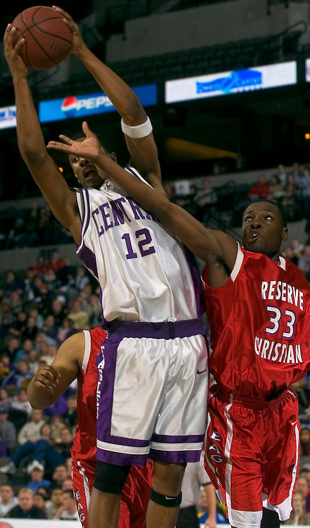 2/11/06 -- Omaha, Ne.Omaha Central's Vondrae Tostensen pulls a rebound way from Reserve Christian's Daniel Johnson.at The Omaha Shootout, a High School Basketball tournament featuring some of the best prospects at the Qwest Center Omaha...(Photo by Chris Machian/Prarie Pixel Group).