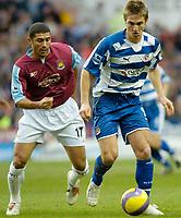 Photo: Gareth Davies.<br />Reading v West Ham United. The Barclays Premiership. 01/01/2007.<br />Reading's Kevin Doyle (R) takes on West Ham's Hayden Mullins (L).