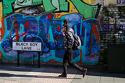 © Licensed to London News Pictures. 22/10/2021. London, UK. A man walks past the Black Boy Lane street sign in north London. Sadiq Khan, Mayor of London has unveiled £25,000 grants to help local communities to change street names as part of a diversity campaign launched following the Black Lives Matter protests. Haringey Council in north London has already moved to change the Black Boy Lane street name. Photo credit: Dinendra Haria/LNP
