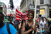 Black Lives Matter supporters at the Peoples Assembly demonstration: No More Austerity - No To Racism - Tories Must Go, onSaturday July 16th in London, United Kingdom. Tens of thousands of people gathered to protest in a march through the capital protesting against the Conservative Party cuts. Almost 150Councillors fromacross the countryhave signed a letter criticising the Government for funding cuts and and will be joining those marching in London. The letter followed the recent budget in which the Government laid out plans to cut support for disabled people while offering tax breaks for big business and the wealthy.