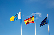 Flags of the European Union, Spain and Canary Islands flying at the airport, Lanzarote, Canary islands, Spain