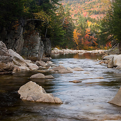 The Swift River in fall as it flows through Rocky Gorge in New Hampshire's White Mountains.  White Mountain National Forest.  Kancamagus Highway.