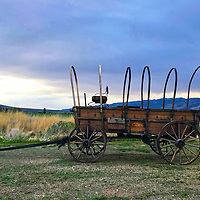 Pioneer wagon marks the California Trail through Elba and the City of Rocks National Monument in Idaho.