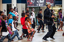 """""""Invincible: A Glorious Tribute to the King of Pop""""  Dancers perform a dance workshop with children at Tutu Park Mall.  Dancers of """"Invincible"""", a Michael Jackson tribute, will perform at Reichhold Center for the Arts Saturday at 7pm.  © Aisha-Zakiya Boyd"""