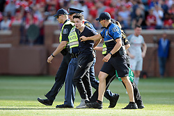 July 28, 2018 - Ann Arbor, Michigan, United States - A fan is removed by police officers after rushing the field during an International Champions Cup match between Manchester United and Liverpool at Michigan Stadium in Ann Arbor, Michigan USA, on Wednesday, July 28,  2018. (Credit Image: © Amy Lemus/NurPhoto via ZUMA Press)