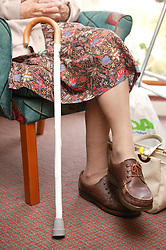 Close up of womans walking stick,
