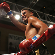 Daniel Rosario of Puerto Rico celebrates his victory over Aaron Garcia for the WBO Latin Superwelterweight title belt  during a Telemundo boxing match at the Kissimmee Civic Center on Friday, July 17, 2014 in Kissimmee, Florida. Rosario won the bout by TKO. (AP Photo/Alex Menendez)
