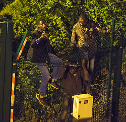 © Licensed to London News Pictures. 09/08/2015. Calais, France. Migrants attempt to access the train tracks to the Eurotunnel terminal at Frethun near Calais, northern France. Hundreds of migrants attempt to illegally access the Eurotunnel complex each night in order to board a train and reach the UK. Photo credit: Ben Cawthra/LNP