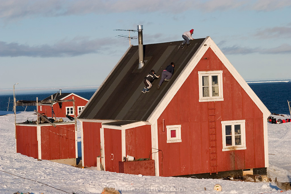 (MODEL RELEASED IMAGE). The Madsen boys, Abraham and Martin, and their cousin Julian, 10, slide down the roof when they find a moment to play. (Supporting image from the project Hungry Planet: What the World Eats.)