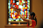 """Liturgical Dancer JaNiece Washington, 16, opens the 33rd Annual African American Heritage Month Eucharistic Celebration at Holy Name Cathedral. This year's mass celebrates the the Nguzo Saba principle of Kuumba, or """"creativity"""" at Holy Name Cathedral."""