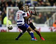 Luke Freeman of Sheffield Utd tackled by Andy Rinomhota of Reading during the FA Cup match at the Madejski Stadium, Reading. Picture date: 3rd March 2020. Picture credit should read: Simon Bellis/Sportimage