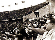 Crowd gives the Nazi salute during the 1936 Berlin Olympic Games.