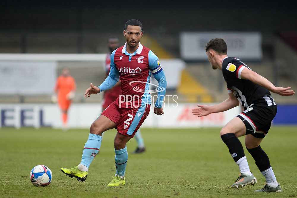 Scunthorpe United Jordan Clarke (2) plays a pass during the EFL Sky Bet League 2 match between Scunthorpe United and Grimsby Town FC at the Sands Venue Stadium, Scunthorpe, England on 23 January 2021.