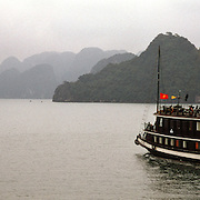 A tourist Junk in Ha Long Bay, Vietnam. The bay consists of a dense cluster of 1,969 limestone monolithic islands. Ha Long Bay, is a UNESCO World Heritage Site, and a popular tourist destination. Ha Long, Bay, Vietnam. Photo Tim Clayton
