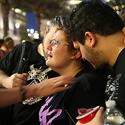 Mourners cry during a vigil at the Dr. Phillips Center for the Performing Arts for the victims of a mass shooting at the Pulse nightclub Monday, June 13, 2016, in Orlando, Florida.  A gunman killed dozens of people in a massacre at the crowded gay nightclub in Orlando on Sunday, making it the deadliest mass shooting in modern U.S. history. (Alex Menendez via AP)
