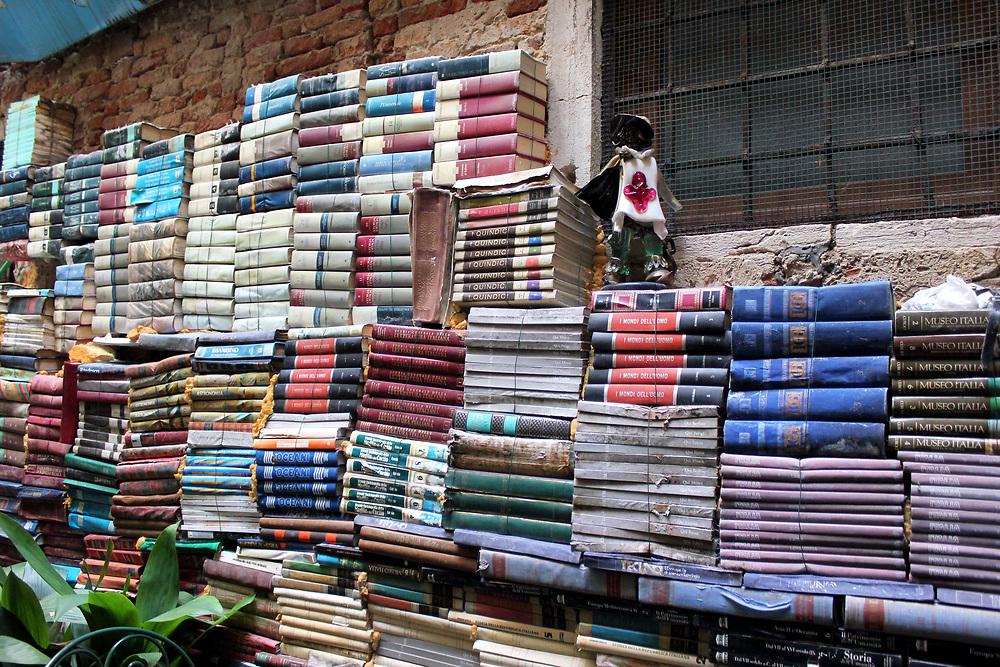 Books piled high. Famous book shop the Acqua Alta, Venice, Italy.