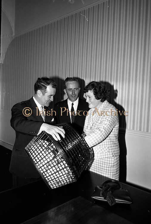 """14/05/1965<br /> 05/14/1965<br /> 14 May 1965<br /> Bord Iascaigh Mhara draw at BIM offices, Mount Street, Dublin. Miss Mary Kenny, """"National Seafood Cook 1965"""" from Donaghmore, Dundalk drawing the winning quiz form tat forecasted her as the winner of the National Fish Cookery Competition. The quiz was held at the Fisheries Pavillion at the Spring Show. The winning entry was submitted by Mr Jim Kenny,23 Kenilworth Road, Rathgar, Dublin. The picture includes Mr B.M. O'Kelly, (left)Chairman of BIM and Mr T.F. Geoghegan, Market Development Manager of BIM."""