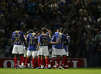 Photo: Lee Earle.<br /> Portsmouth v Leeds United. Carling Cup. 28/08/2007.Portsmouth players congratulate Noe Pamarot after he scored their opening goal.