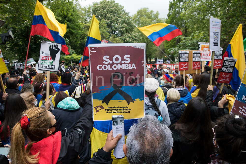 SOS Colombia activists highlight human rights abuses taking place in Colombia as part of an International Bloc on the National Demonstration for Palestine on 22nd May 2021 in London, United Kingdom. The demonstration was organised by pro-Palestinian solidarity groups in protest against Israels recent attacks on Gaza, its incursions at the Al-Aqsa mosque and its attempts to forcibly displace Palestinian families from the Sheikh Jarrah neighbourhood of East Jerusalem.