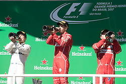 November 12, 2017 - Sao Paulo, Sao Paulo, Brazil - From left to right, VALTTERI BOTTAS, SEBASTIAN VETTEL and KIMI RAIKKONEN  celebrate after the Formula One Grand Prix of Brazil at Interlagos circuit, in Sao Paulo, Brazil on November 12, 2017. (Credit Image: © Paulo Lopes via ZUMA Wire)