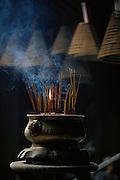 Incense burns in Macau's Temple of Kun Iam Tong (goddess of mercy)