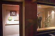 The ground floor entrance to Kajitsu. The restaurant's sign is inside the door.