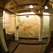 Large wall maps with pins chart the progress of the war at the Churchill War Rooms in London. The museum, one of five branches of the Imerial War Museums, preserves the World War II underground command bunker used by British Prime Minister Winston Churchill. Its cramped quarters were constructed from a converting a storage basement in the Treasury Building in Whitehall, London. Being underground, and under an unusually sturdy building, the Cabinet War Rooms were afforded some protection from the bombs falling above during the Blitz.