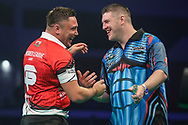 Gerwyn Price and Daryl Gurney during the Unibet Premier League darts at Motorpoint Arena, Cardiff, Wales on 20 February 2020.