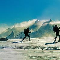 Jon Krakauer & Conrad Anker ski below the Filchner Mountains, Queen Maud Land, Antarctica.