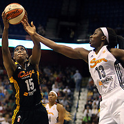 Roneeka Hodges, (left), Tulsa Shock, rebounds while challenged by Chiney Ogwumike, Connecticut Sun, during the Connecticut Sun Vs Tulsa Shock WNBA regular season game at Mohegan Sun Arena, Uncasville, Connecticut, USA. 3rd July 2014. Photo Tim Clayton
