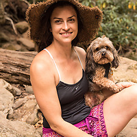 Portrait of a local (model released) with her dog Max. Skinny Dip Falls is a popular waterfall and swimming hole along the Blue Ridge Parkway in the Pisgah National Forest southwest of Asheville, North Carolina. The half-mile long trail is accessed from the parking lot at the Looking Glass Rock Overlook at milepost 417.
