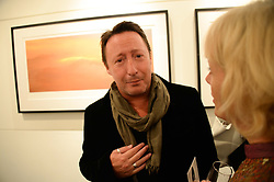 JULIAN LENNON at a private view of Photographs by Julian Lennon held at The Little Black Gallery, 13A Park Walk, London SW10 on 17th September 2013.