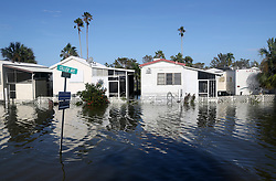 September 11, 2017 - Everglades City, Florida, U.S. - Mobile homes remain flooded off Collier Avenue on Monday in downtown Everglades City, which became inundated with water in the aftermath of Hurricane Irma's landfall on Sunday. (Credit Image: © Douglas R. Clifford/Tampa Bay Times via ZUMA Wire)