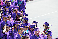Grads file into The Pit at Salinas High School's 2014 commencement ceremony on Thursday in Salinas.