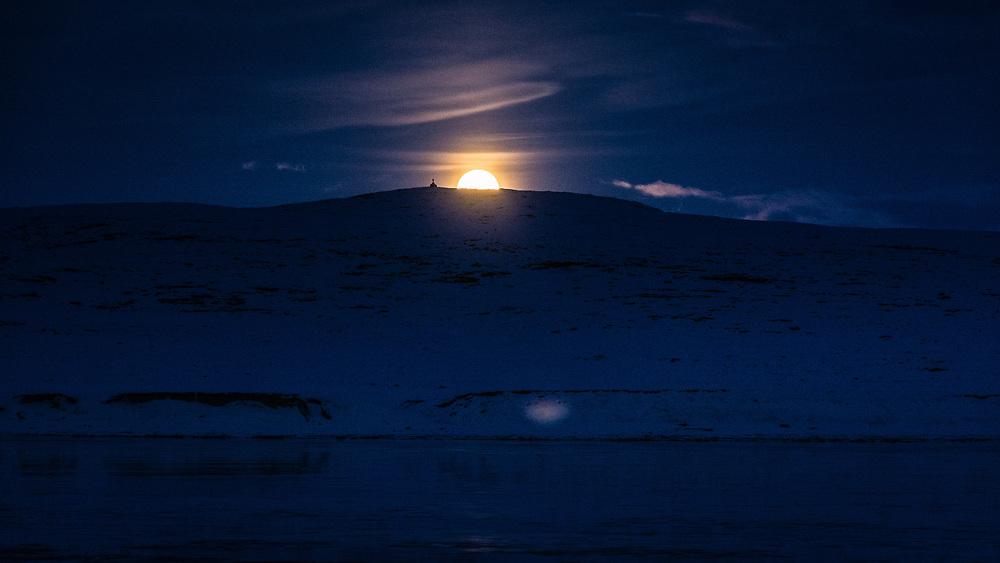 Moonraising behind the east beacon.