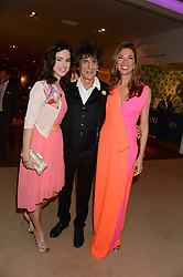 Left to right, SALLY HUMPHREYS, RONNIE WOOD and HEATHER KERZNER at the Masterpiece Midsummer Party in aid of Marie Curie Cancer Care held at The Royal Hospital Chelsea, London on 2nd July 2013.