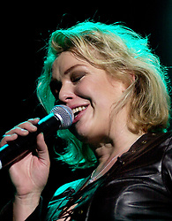 Kim Wilde steps out of the her TV Gardening clothes and Back on Stage to Tour with<br /><br />Steve Starnge (Visage)<br />Claire Grogan (Altered Images)<br />The Belle Stars<br />Dollar<br />Kim Wilde<br />The Human League<br />Play on the Here and Now  Christmas Party Tour at Sheffields Hallam FM Arena Friday 13th December 2002<br /><br />[#Beginning of Shooting Data Section]<br />Nikon D1 <br />2002/12/13 22:48:24.0<br />JPEG (8-bit) Fine<br />Image Size:  2000 x 1312<br />Color<br />Lens: 80-200mm f/2.8-2.8<br />Focal Length: 100mm<br />Exposure Mode: Manual<br />Metering Mode: Spot<br />1/200 sec - f/2.8<br />Exposure Comp.: 0 EV<br />Sensitivity: ISO 800<br />White Balance: Auto<br />AF Mode: AF-S<br />Tone Comp: Normal<br />Flash Sync Mode: Not Attached<br />Color Mode: <br />Hue Adjustment: <br />Sharpening: Normal<br />Noise Reduction: <br />Image Comment: <br />[#End of Shooting Data Section]