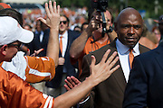 AUSTIN, TX - AUGUST 30:  Texas Longhorns head coach Charlie Strong walks with his team during the Stadium Stampede as they enter the stadium before kickoff against the North Texas Mean Green on August 30, 2014 at Darrell K Royal-Texas Memorial Stadium in Austin, Texas.  (Photo by Cooper Neill/Getty Images) *** Local Caption *** Charlie Strong