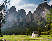 Saint Sylvester's Chapel (San Silvestro) in Vallunga is dedicated to the patron saint of cattle and contains 300-year-old frescoes depicting the life of Jesus. Walk through the beautiful, deeply glaciated, U-shaped valley of Vallunga/Langental in Puez-Geisler Nature Park (Italian: Parco naturale Puez Odle; German: Naturpark Puez-Geisler) near Selva di Val Gardena, in the Dolomites, Italy, Europe. The mostly Ladin-speaking town of Sëlva Gherdëine (German: Wolkenstein in Gröden; Italian: Selva di Val Gardena) is in Südtirol/South Tyrol/Alto Adige, in the Dolomiti, part of the Southern Limestone Alps. Panorama stitched from 3 overlapping photos.