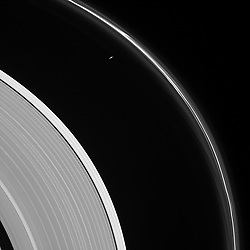 August 7, 2017 - Space - The thin sliver of Saturn's moon Prometheus lurks near ghostly structures in Saturn's narrow F ring in this view from NASA's Cassini spacecraft. Many of the narrow ring's faint and wispy features result from its gravitational interactions with Prometheus (86 kilometers, or 53 miles across).Visible here is a distinct difference in brightness between the outermost section of Saturn's A ring (left of center) and rest of the ring, interior to the Keeler Gap (lower left). This view looks toward the sunlit side of the rings from about 13 degrees above the ring plane. The image was taken in visible light with the Cassini spacecraft narrow-angle camera on May 13, 2017. The view was acquired at a distance of approximately 680,000 miles (1.1 million kilometers) from Saturn. Image scale is 4 miles (6 kilometers) per pixel. (Credit Image: © JPL-Caltech/Space/NASA/ZUMA Wire/ZUMAPRESS.com)